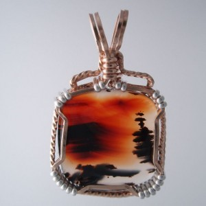 "A small Montana Agate with a ""big sky"" picture."
